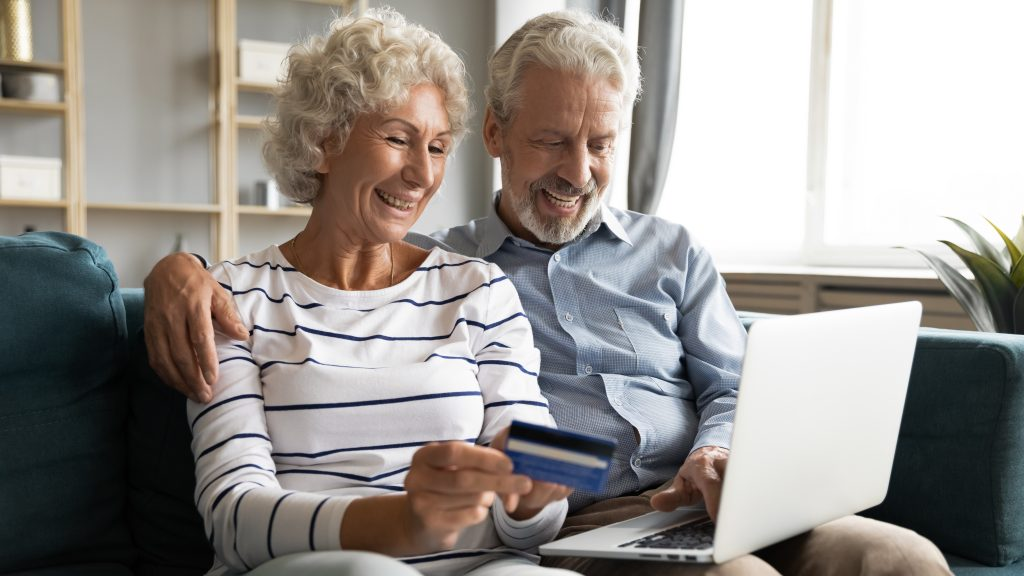 Smiling couple shops online