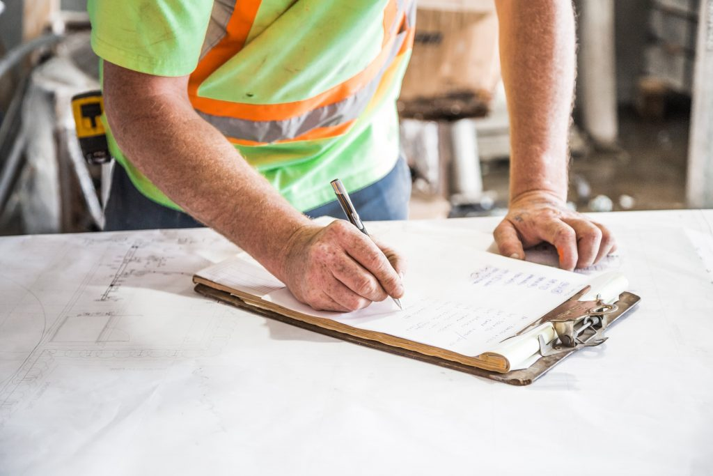 Construction worker uses clipboard
